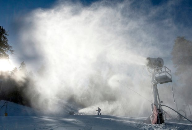 A skier makes his way past snowblowers on Coyote run during the opening day at Mountain High in Wrightwood, Calif., in 2016. Skiers and snowboarders hit the slopes in the cold weather. (Jeff Gritchen/The Orange County Register/SCNG via AP)