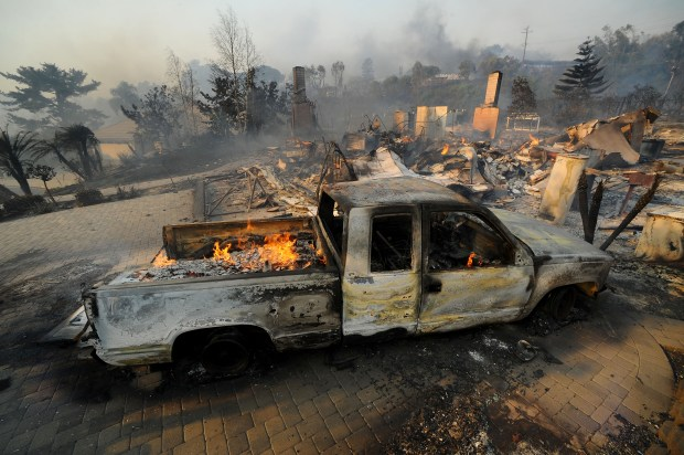 The Thomas Fire burned many homes in the Nob Hill Estates area near Ventura Tuesday morning. A Santa Ana wind event has created extreme fire conditions around the Southland.(Photo by Andy Holzman/SCNG)