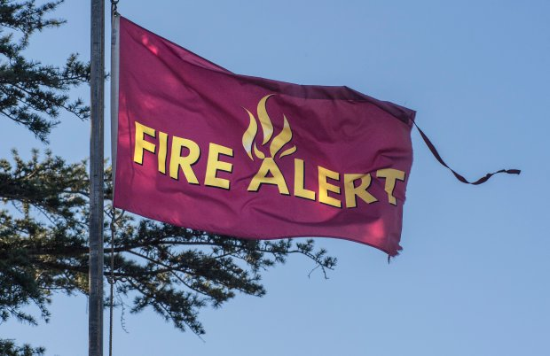 A fire alert flag flies in the wind at the headquarters of Irvine Regional Park in Orange as Santa Ana winds continue to blow early Tuesday morning December 5, 2017. (Photo by Mark Rightmire, Orange County Register/SCNG)
