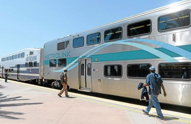 Passengers board the Metrolink train at the Rancho Cucamonga station, Tuesday afternoon, July 15, 2014. A financial dispute between Metrolink and SanBAG will result in four weekday trains between San Bernardino and Los Angeles being cut starting in October. (Photo by John Valenzuela/Inland Valley Daily Bulletin)