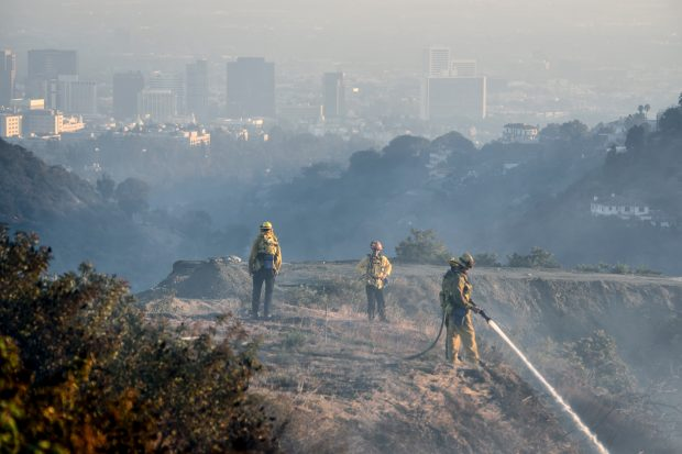 LA City firefighters put out hot spots in the Skirball Fire on a canyon along Linda Flora Drive in the Bel Air neighborhood of Los Angeles, California, on Wednesday, December 6, 2017. (Photo by Jeff Gritchen, Orange County Register/SCNG)