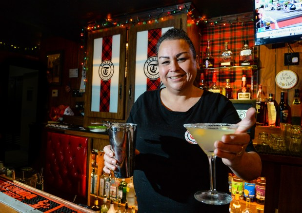 Bartender Lisa Vanderpol makes an orange drop martini at the Tartan in Redlands, Calif. on Tuesday, Dec. 12, 2017. The Tartan is one of a few downtown restaurants participating in an Orange Drop Martini contest as part of the Redlands Chamber of Commerce's inaugural Orange Drop event New Year's Eve in downtown Redlands. (Photo by Rachel Luna, Redlands Facts/SCNG)