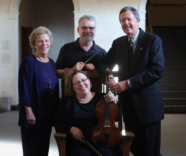Robin Maupin, left, and David Maupin, right, have given $50,000 to the Redlands Symphony to go toward funding the orchestra's principal viola chair. With them are Ransom Wilson, center, the orchestra's music director, and Kira Blumberg, seated, principal violist. (Courtesy Photo)