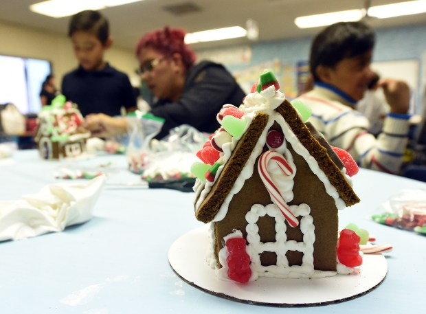 Kindergarten students at Arroyo Elementary School in Pomona decorate gingerbread houses Thursday December 14, 2017. Arroyo kindergarten teacher Karen Shietze has been bringing the gingerbread houses to her students for the past 20 years for them to decorate. (Photo by Will Lester-Inland Valley Daily Bulletin/SCNG)