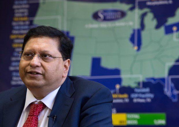 With a map of ambitious plans for expansion as a backdrop, Tonmoy Sharma, founder and CEO of Sovereign Health, an addiction treatment company, talks about the recent FBI raid earlier this year in San Clemente. (File photo by Mindy Schauer, Orange County Register/SCNG)