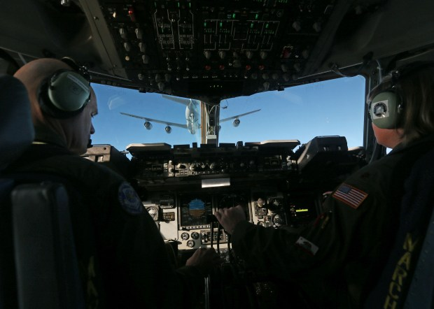 A KC-135 Stratotanker can be seen through the flight deck of an Air Force ReserveÕs 452nd Air Mobility Wing C-17 after completing an air refueling mission on Monday, Dec. 19, 2017 after leaving March Air Reserve Base in Moreno Valley. (Stan Lim, The Press-Enterprise/SCNG)