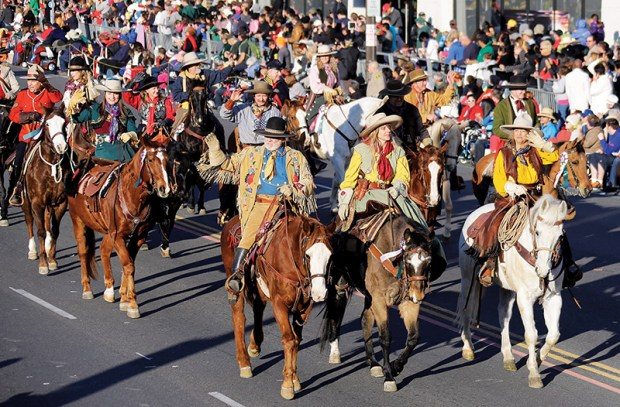 The Spirit of the West Riders participate in the 125th Rose Parade in Pasadena, Calif., Wednesday, Jan. 1, 2014. (AP Photo/Reed Saxon) ORG XMIT: CARS116