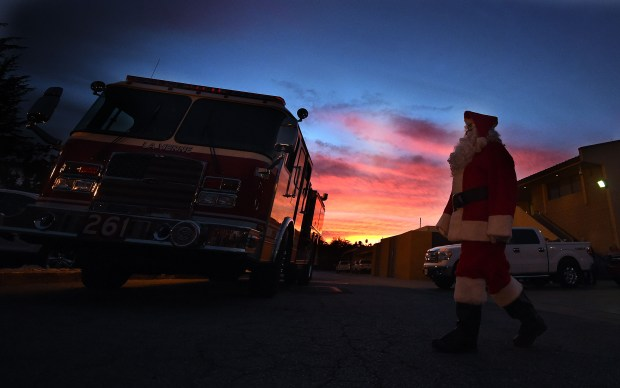 A volunteer dressed as Santa Claus prepares for the La Verne Fire departments 92nd annual candy delivery Monday morning.For the 92nd year the La Verne Fire Department, with the help of over 70 volunteers, carried out their annual Christmas morning candy delivery to the residents of La Verne Monday morning December 25, 2017. Approximately 11,000 bags of candy and peanuts were handed out to residents as fire trucks drove through all the neighborhoods of the city hand delivering items to both adults and children who came out of their homes, many still dressed in pajamas. (Photo by Will Lester-Inland Valley Daily Bulletin/SCNG)