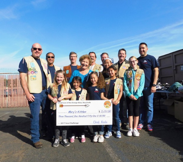 Helping deliver the Inca's donation to Mary's Kitchen are, in back, Inca Indian Princess dads Norman McGrane, George Garcia, John Sommer, Norbert Lippert, Dan Hughes, Inca Chief Brendan Timpane, and Steve Peery; Gloria Suess, CEO/President of Mary's Kitchen, and Indian Princess daughters  Gaige McGrane, Gia Garcia, Ava Peery, Olivia Garcia, Ava Garcia, and Claire Hughes. (Courtesy of Andrea Mills)