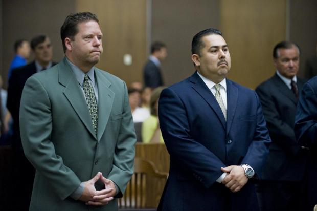 Fullerton police officer Jay Cicinelli, left, and former Fullerton police officer Manuel Ramos, right, pleaded not guilty in 2012 in the beating death of transient Kelly Thomas as they appeared briefly in Orange County Superior Court in Santa Ana, for their arraignment. (Staff File)
