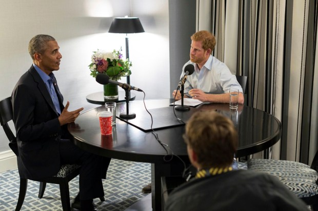 In this photo issued on Sunday Dec. 17, 2017 by Kensington Palace courtesy of the Obama Foundation, Britain's Prince Harry, right, interviews former US President Barack Obama as part of his guest editorship of BBC Radio 4's Today program, which is to be broadcast on Dec. 27, 2017. The interview was recorded in Toronto in September 2017 during the Invictus Games. (Kensington Palace courtesy of The Obama Foundation via AP)