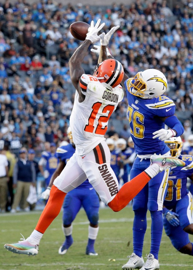 Chargers cornerback Casey Hayward, right, breaks up a pass intended for Cleveland Browns wide receiver Josh Gordon during the second half a game at StubHub Center in Carson on Dec. 3. Hayward played that game days after his brother died in a car accident. (AP Photo/Jae C. Hong)