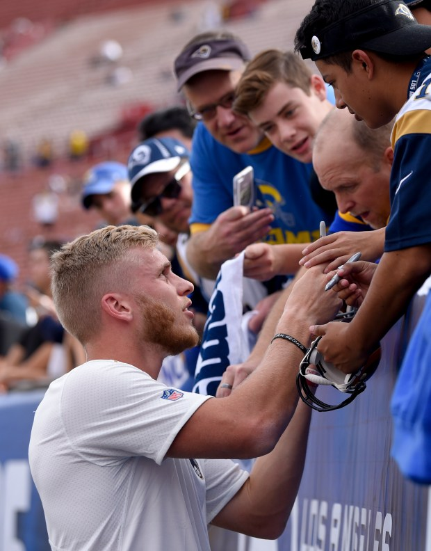 Los Angeles Rams wide receiver Cooper Kupp signs autographs before an NFL football game against the Philadelphia Eagles Sunday, Dec. 10, 2017, in Los Angeles. (AP Photo/Mark J. Terrill)