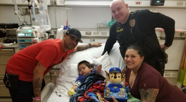 Riverside police Officer Darrell Hill visits with Ezra Cadena, 3, of Moreno Valley at Loma Linda University Children's Hospital. Hill performed CPR on Ezra during a medical emergency Christmas evening at his grandparent's Riverside home. (Courtesy Eric Nunez)