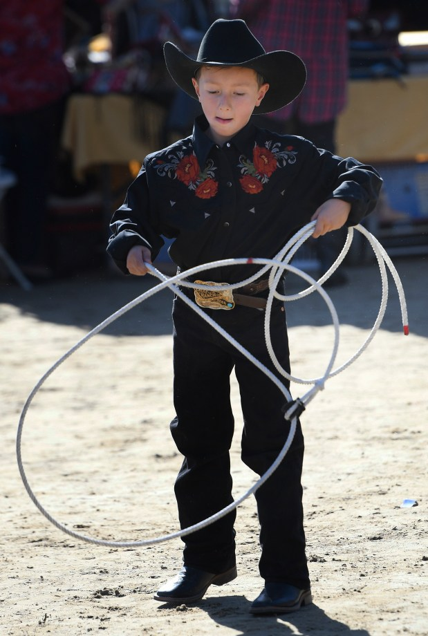 Jaden White,9, a member of the Broken Horn Ropers, practices his loops during Equestfest, held at the Los Angeles Equestrian Center. The event showcased many of the equestrian units that will participate in the Rose Parade on New Year's Day. Burbank, CA 12/29/2017 (Photo by John McCoy, Los Angeles Daily News/SCNG)