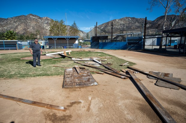 Sylmar Independent Baseball League President Joe Kirk looks at damage to their facility by high winds during the Creek Fire in Sylmar. (Photo by Hans Gutknecht, Los Angeles Daily News/SCNG)