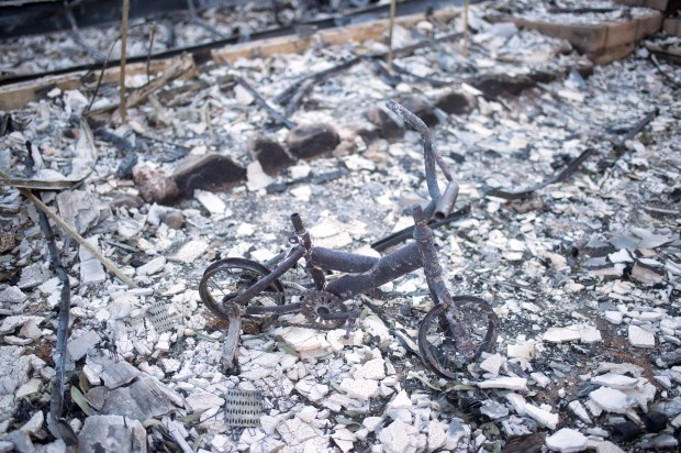 A bike that was a Christmas present for Cory and Jennifer Lagusker's child is seen in the wreckage of their home on Gold Creek Road in Sylmar that burned during the Creek fire. The couple run an animal sanctuary at the location and evacuated 500 animals safely during the fire. (Photo by Hans Gutknecht, Los Angeles Daily News/SCNG)