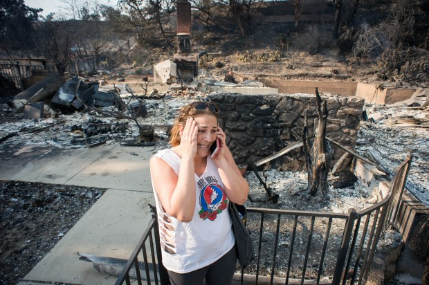 """Daddy the home is gone,"" says Amanda Lewis, of the home on Colina Vista in Ventura where she grew up. Lewis called her family after checking on the home on Wednesday, Dec. 6, 2017, after the Thomas fire raged through her parent's foothill neighborhood. (Photo by Sarah Reingewirtz, Pasadena Star-News/SCNG)"