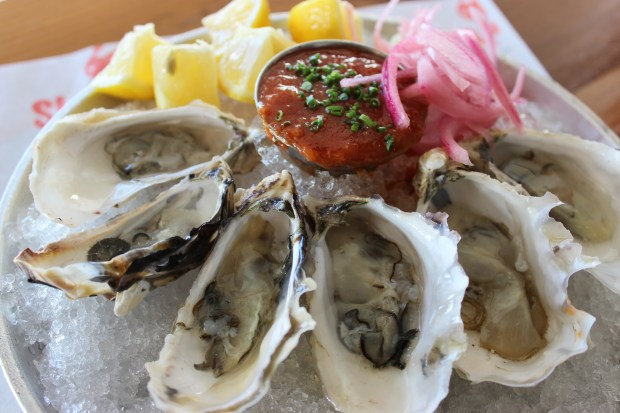 Andrew Gruel, co-founder of Slapfish, is launching a new chilled seafood concept in Huntington Beach. Oyster Bar will open in January next door to the flagship Slapfish on Beach Boulevard. (Courtesy Slapfish/Oyster Bar)