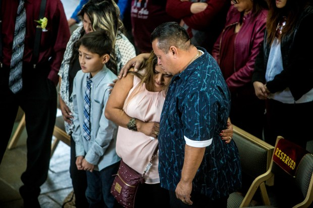 Yucaipa resident Charlene Avila-Olague, center, is comforted by husband, Freddie Avila-Olague, during the funeral service for their daughter, Rosalie Avila, 13, at Rose Hills Memorial Park in Whittier on Wednesday, Dec. 20, 2017. The Mesa View Middle School eighth grader committed suicide after her parents say she was bullied.
