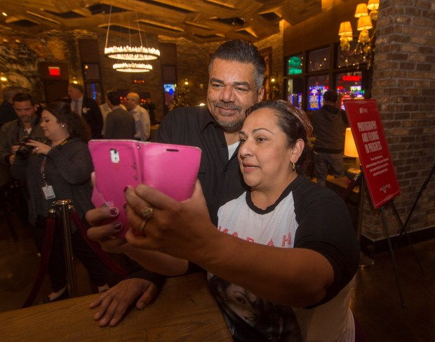 Comedian George Lopez takes a selfie with Yolanda Saucedo of Rialto in his Chingon Restaurant at San Manuel Casino in Highland. (Photo by Frank Perez, correspondent)