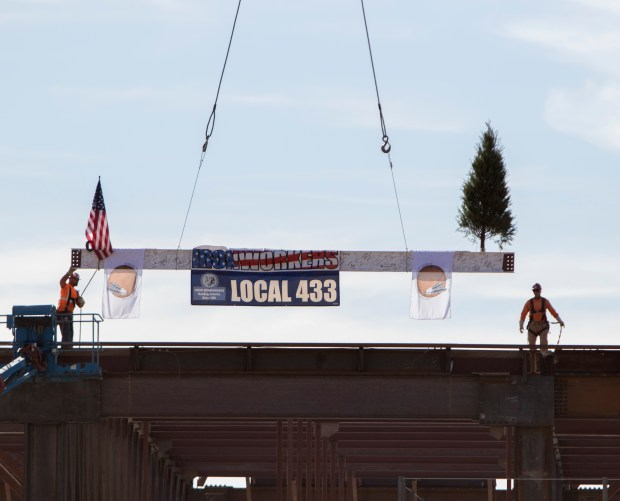 Workers set a beam that was signed by workers and tribal members in place on the new Soboba Hotel and Casino near San Jacinto on Monday, Dec. 11.Photo by Andrew Foulk, contributing photographer