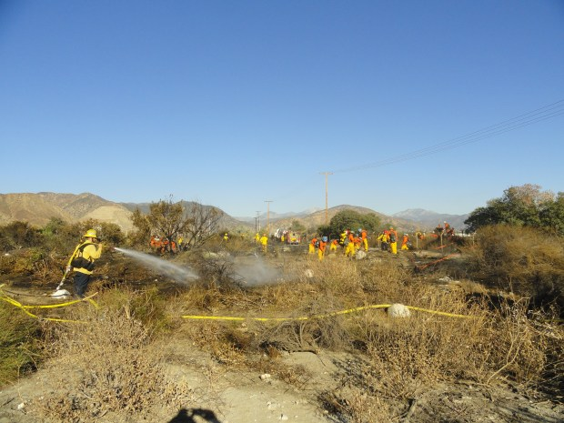 Firefighters battle a brush fire that broke out at Lario Park, 3089 E. Huntington Drive in Irwindale, that broke out shortly after 1 p.m. on Wednesday, Dec. 6, 2017. (Courtesy, Irwindale Police Department)