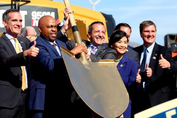 Metro CEO, Phillip Washington (center left) and Foothill Gold Line Construction Authority CEO, Habib Balian (center right) hold up a giant shovel as they pose for photos with Los Angeles Mayor, Eric Garcetti, and other elected officials and board members during a groundbreaking ceremony for the extension of the Foothill Gold Line at Citrus College in Glendora, Calif. on Saturday, Dec. 2, 2017. The Gold Line will extend from Glendora to Montclair, further connecting the San Gabriel Valley with the rest of Los Angeles county. (Correspondent photo by Trevor Stamp)