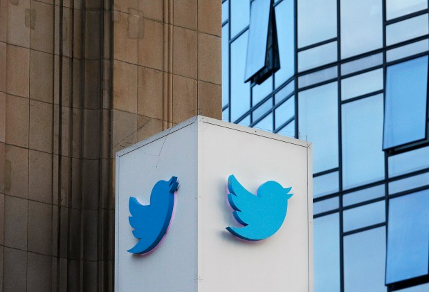 San Francisco-based Twitter will be enforcing stricter policies on violent and abusive content such as hateful images or symbols, including those attached to user profiles, the company announced Monday, Dec. 18, 2017. (AP Photo/Jeff Chiu)