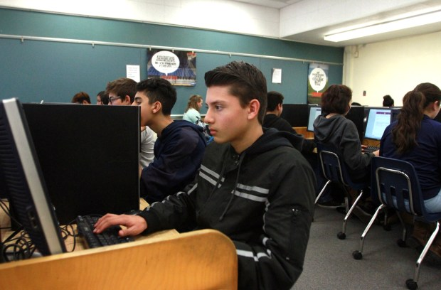 Redlands High School student Joseph Rabago, 14, answers survey questions through the new ThoughtExchange program on Friday, Jan. 12, 2018 at Redlands High School in Redlands, Calif. The Redlands Unified School District is collecting input on what it can do to bring change to the classroom through its ThoughtExchange program.  (Micah Escamilla/Correspondent)