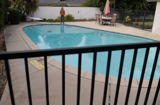 New state law that took effect Jan. 1, regarding California swimming pools and spas built or remodeled starting in 2018 must have a second safety feature to protect children from drowning, such as fences around the pool, a door alarm or an automatic pool cover. Photo by John Valenzuela/Press Enterprise/SCNG