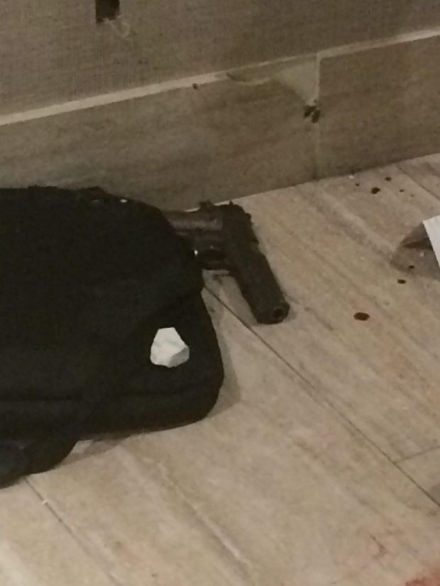This gun was recovered at the scene of what police are calling a hostage situation early Friday, Jan.5, 2018, at the Holiday Inn Long Beach Airport, where officers shot and killed an armed man holding at least one hostage. (Photo courtesy of the Long Beach Police Department)