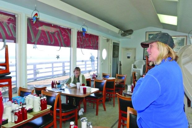 Diner Jeannie Gilliam at Polly's on the Pier with owner JoAnn Turk in the background. Photo by David Rosenfeld.
