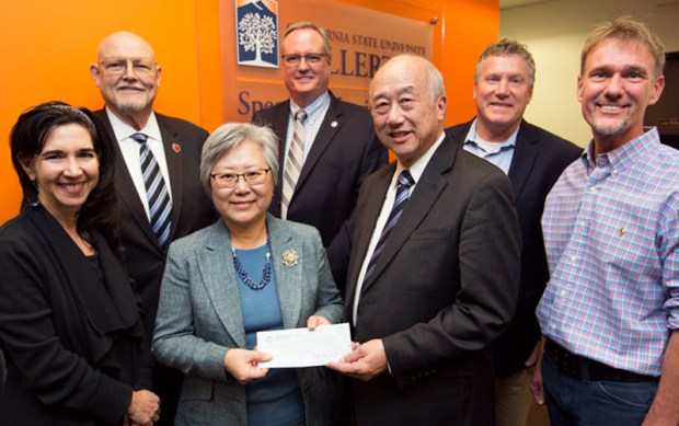 Frank Loui, president and chairman of the California Scottish Rite Foundation, presents a check to HyeKeung Seung, chair of Cal State Fullerton's Communication Sciences and Disorders Department. Flanking them, from left, are: Sherri Wolff, Raymond Godeke, Edward Fink, Greg Saks and Phil Weir-Mayta. (Photo courtesy of Cal State Fullerton)