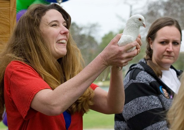 Erin Runnion, founder of the Joyful Child Foundation and mother of 5-year-old Samantha Runnion, who was murdered in 2002, releases a dove in Samantha's honor during the Survive & Thrive event for crime victims at William R. Mason Regional Park in Irvine in 2015. (Mindy Schauer, file photo)