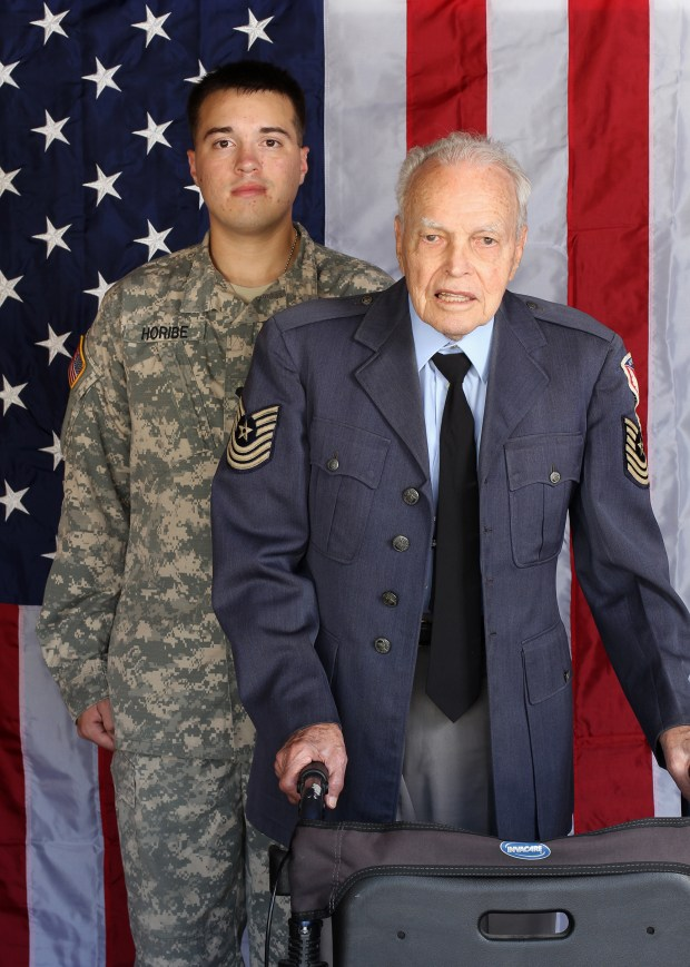 """Robert L. """"Bob"""" Gibbons, USAF, MSgt, Ret., who served in WWII and the Korean War, poses for a family photo in 2012 with his grandson, Gregg Horibe, Army, Ret. Gibbons died on Dec. 23, 2017. He was a resident of Huntington Beach."""