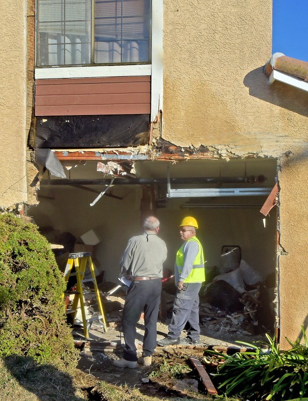 Contruction  crew discussing repair of damage caused by  driver of Athens Services garbage truck hits a parked mini van then plows into a town home on the 6100 block of Rosemead Boulevard in Temple City, CA., Thursday, January 11, 2018.  No injuries was reported. (Photo by Walt Mancini/Pasadena Star News/SCNG)
