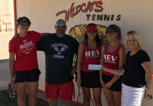 Bev Krick, right, Redlands Racquet Club president, presents a donation to the Redlands East Valley High School girls' tennis team. From left are captain Hannah Washburn, coach Ed Stark, Monica Madrid and captain Natalie Zander. (Courtesy Photo)