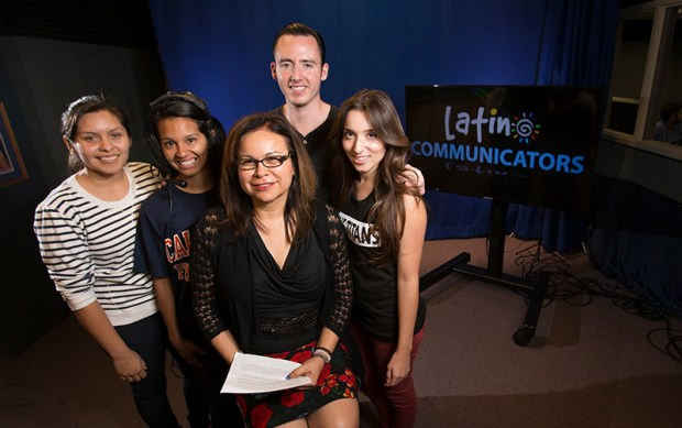Surrounding Inez González, center, director of the Latino Communications Institute at Cal State Fullerton, are, from left, students and alumni Anahi Velasco, Cristal Ruiz, Jeffrey Whitten and Esmeralda Cisneros. (Photo courtesy of Cal State Fullerton)