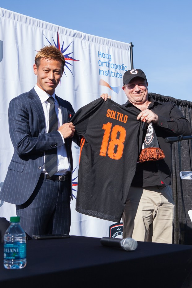 Keisuke Honda and Orange County Soccerowner James Keston pose for a photo at a press conference announcing a partnership between OCSC and Soltilo on Dec. 29, 2018, at the Orange County Great Park championship soccer stadium in Irvine. (Liza Rosales, Liza Rosales Photography)