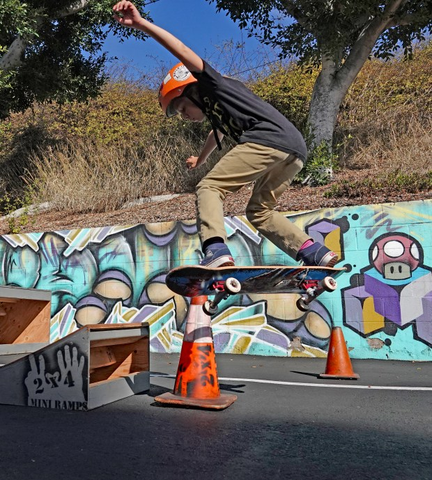 Spencer Davis, a member of the band Stink Inc., catches some air at the San Clemente Skatepark Coalition's Jan. 14 fundraiser at Zebra House Coffee. (Photo by Fred Swegles; Orange County Register/SCNG)