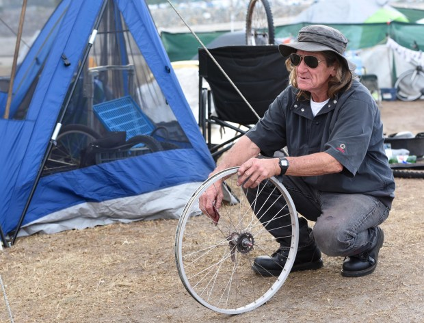 "Kemmeth Tully describes himself as ""feral"" because of his preference to live unfettered outdoors. He's been living on the streets for at least nine years, some of that time at Central Park in Huntington Beach. Photo by Bill Alkofer, Orange County Register/SCNG)"
