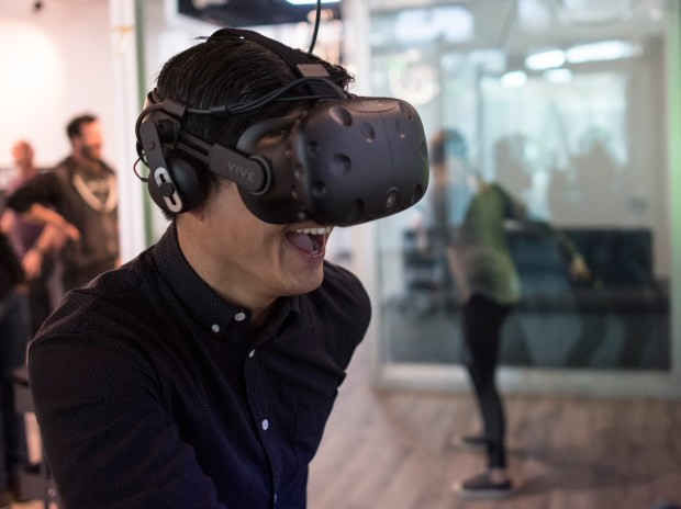 Survios CFO and Vice President of Business Development Ben Kim plays the company's game Sprint Vector with Business Development associate Megan Massok at Del Amo Fashion Center in Torrance on Tuesday, January 23, 2018. The Los Angeles-based virtual reality video game developer Survios will open its first-ever arcade at TorranceÕs Del Amo Fashion Center. (Photo by Kyusung Gong/Contributing Photographer)