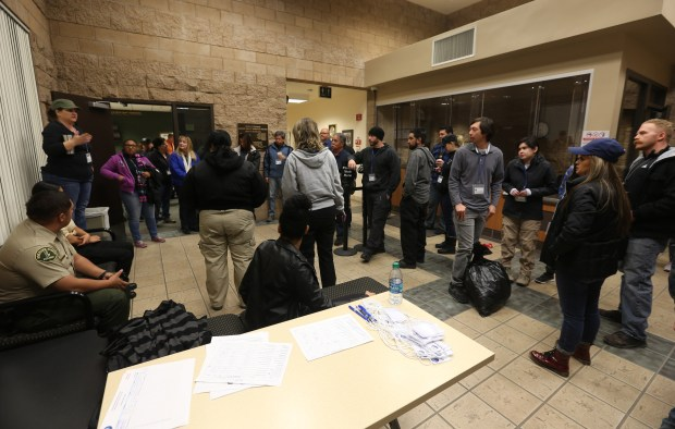 Volunteers break into groups at the Riverside County Sheriff's Station in Jurupa Valley before heading out for the annual Point-In-Time Homeless Count and survey in Jurupa Valley on Tuesday, Jan. 23, 2018. (Stan Lim, The Press-Enterprise/SCNG)