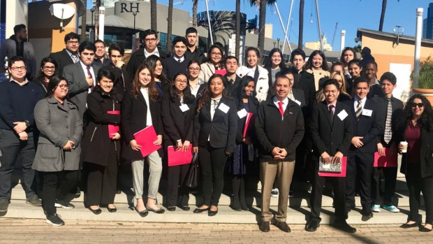 State Sen. Tony Mendoza stoked tensions by posting photos of himself touring the Port of Long Beach with high school students through the Senate-sponsored Young Senators program.