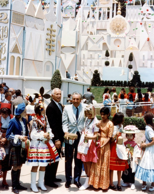 Walt Disney participates in the grand opening of It's a Small World at Disneyland in 1966. The dolls inside first started singing the song at the 1964 New York World's Fair. After the fair opened, Disney had the attraction brought to California where it was put into a building built for it at the north end of Disneyland.