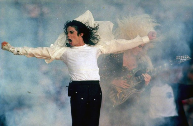 In this Jan. 31, 1993 file picture, Michael Jackson performs during the halftime show at the Super Bowl XXVII in Pasadena, Calif. The Super Bowl show can easily be divided into two eras: before and after Michael Jackson. His 1993 performance established halftime as something more than an afterthought. With the fireworks and extras, Jackson proved no gesture could be too big. (File photo by Rusty Kennedy, Associated Press)