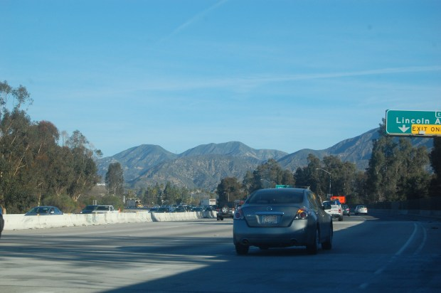 Cars travel the newly finished section of the eastbound 210 Freeway in Northwest Pasadena on Friday, Jan. 26, 2018. The bypass lane is removed and lanes restriped. (Photo by Steve Scauzillo)