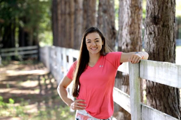U.S. gymnast Maggie Nichols poses at the Karolyi Ranch Saturday, Sept. 12, 2015, in New Waverly, Texas. (AP Photo/David J. Phillip)
