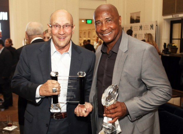 Bob Miller, left, is joined by USC athletic director Lynn Swann as they are honored during the Day at the Races & Monte Carlo Night to benefit the Jim Murray Memorial Foundation's Scholarships for journalism students at Santa Anita Park on Sept. 30. (Photo by James Carbone for the Pasadena Star News/SCNG)
